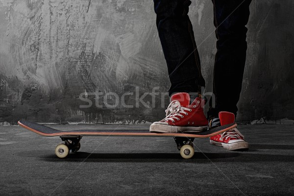 Legs in sneakers on a skateboard Stock photo © Nejron