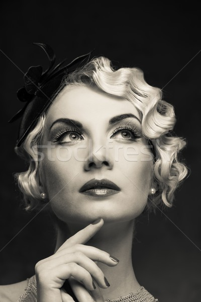Monochrome portrait of elegant blond retro woman   with beautiful hairdo and little hat Stock photo © Nejron