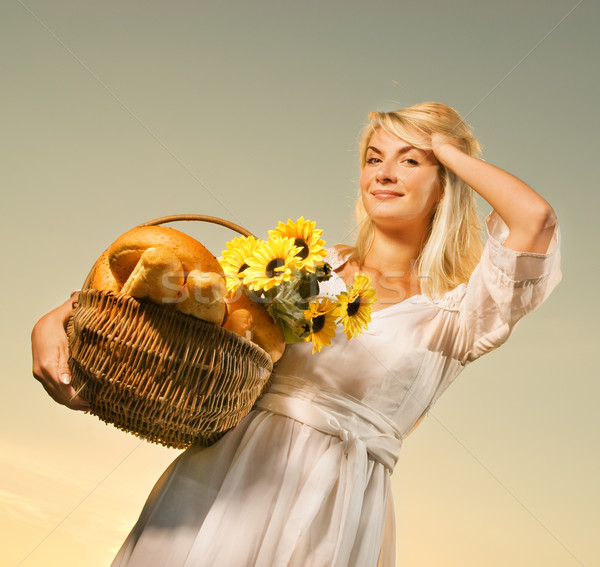 Young beautiful woman with a bouquet of sunflowers in the field  Stock photo © Nejron