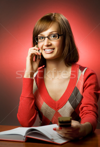 Beautiful redhead woman searching a phone number in telephone di Stock photo © Nejron