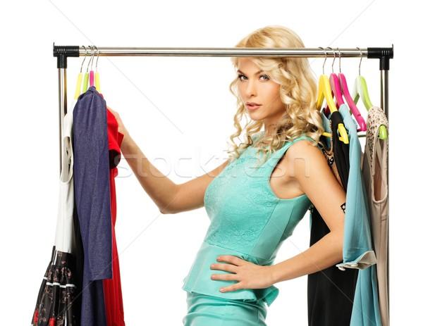 Blond woman choosing clothes on a rack  Stock photo © Nejron