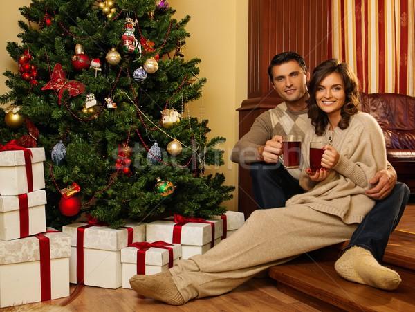 カップル カップ ホットドリンク クリスマスツリー 家族 笑顔 ストックフォト © Nejron