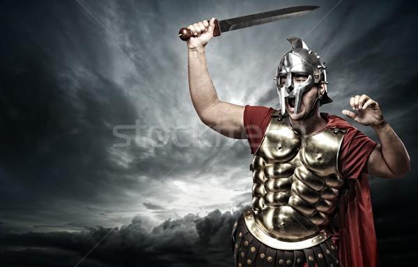 Stockfoto: Soldaat · stormachtig · hemel · achtergrond · metaal · macht
