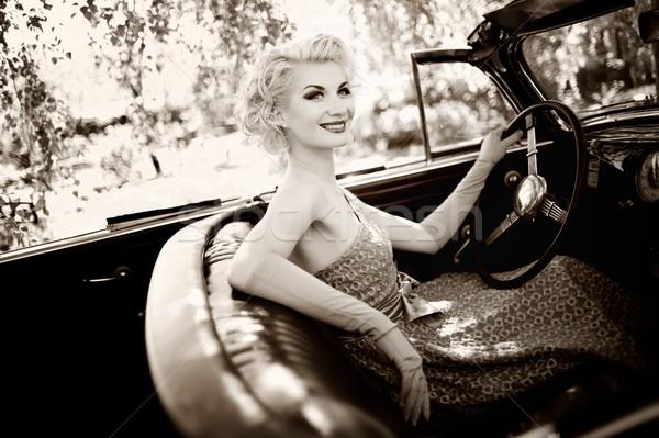 Smiling retro woman in convertible Stock photo © Nejron