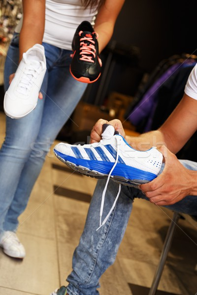 People choosing sports footwear in sport outlet Stock photo © Nejron