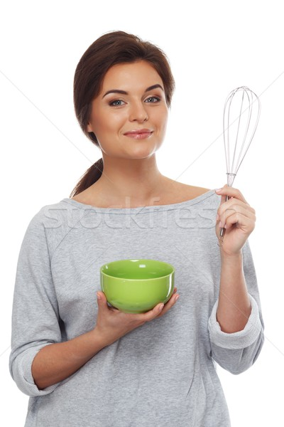 Young brunette woman with plate and whisk tool Stock photo © Nejron
