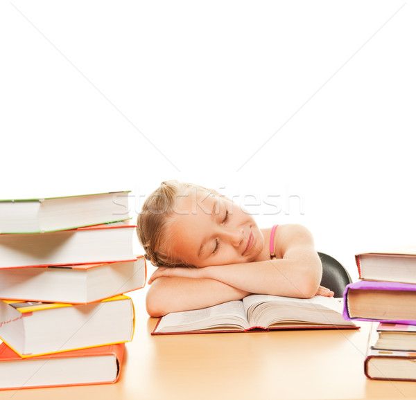 Little schoolgirl fall asleep after reading a book
