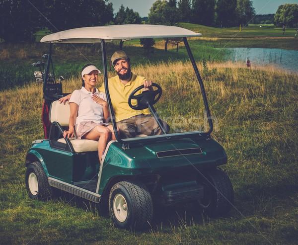 Happy couple driving golf cart  Stock photo © Nejron