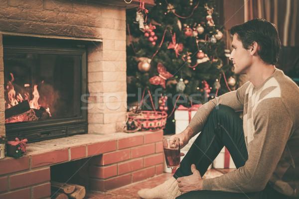 男 カップ ホットドリンク 暖炉 クリスマス 装飾された ストックフォト © Nejron