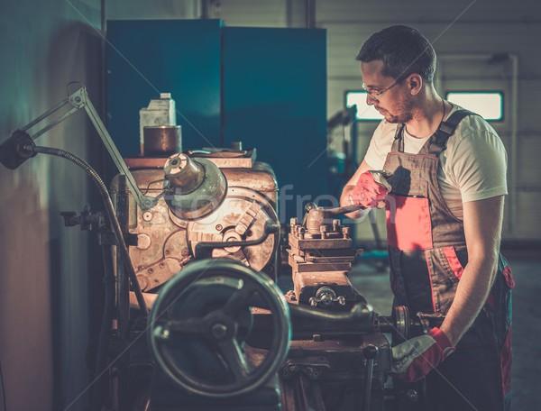 Serviceman working on lathe machine in car workshop Stock photo © Nejron