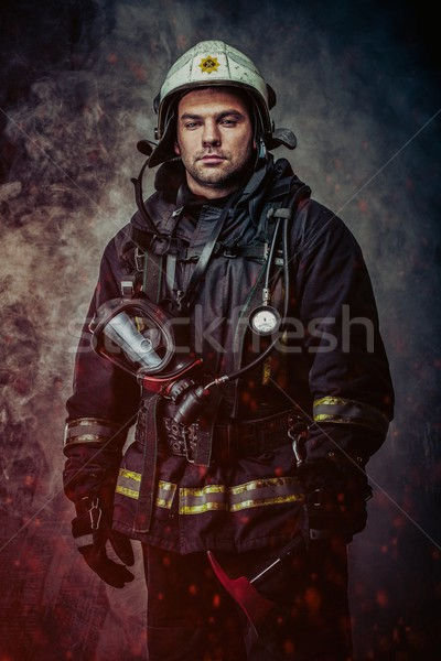 Firefighter with helmet and axe in a smoke Stock photo © Nejron