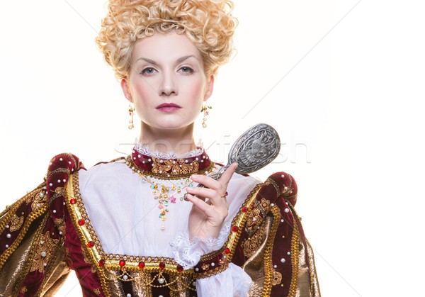 Haughty queen in royal dress isolated on white Stock photo © Nejron
