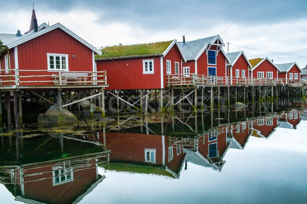 Traditional wooden houses on a water in norwegian village Stock photo © Nejron