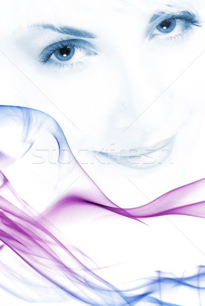 Beutiful girl's face toned in blue with abstract colorful smoke  Stock photo © Nejron