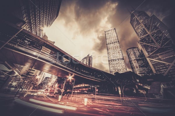 Fast moving cars at night in modern city Stock photo © Nejron