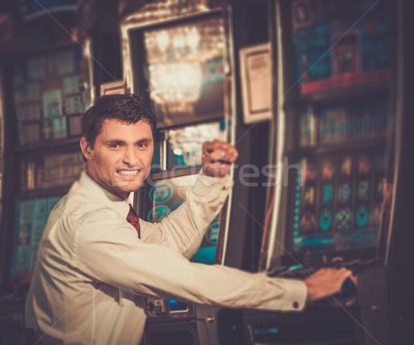 Jóképű boldog barna hajú férfi fehér póló Stock fotó © Nejron
