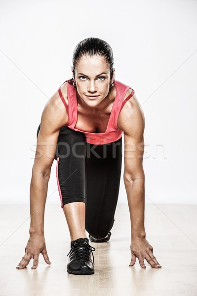 Beautiful athlete woman doing fitness exercise Stock photo © Nejron