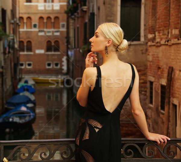 Beautifiul woman in black dress on a bridge Stock photo © Nejron