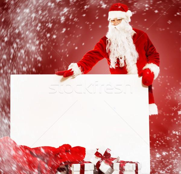 Mikulás zsák tele ajándékdobozok hirdetőtábla arc Stock fotó © Nejron
