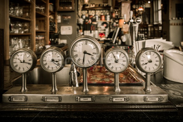 Vintage clocks on a bar counter in a pub Stock photo © Nejron