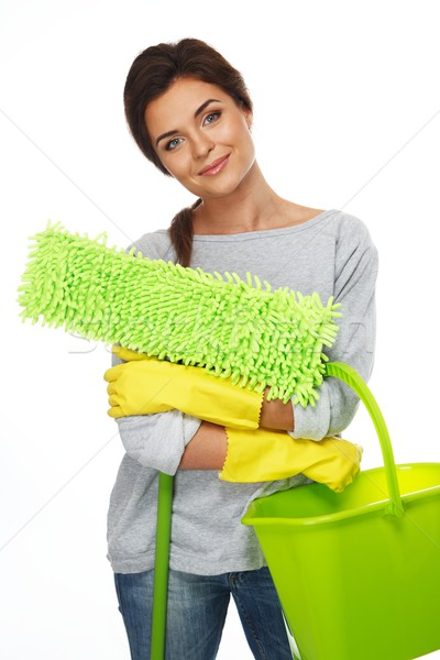 Beautiful cheerful brunette woman in gloves with mop and bucket Stock photo © Nejron
