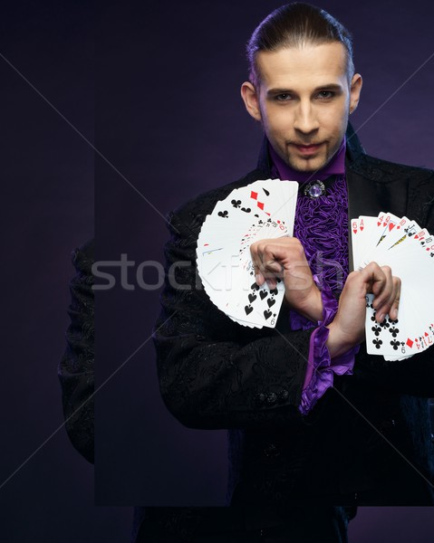 Young brunette magician in stage costume showing card tricks  Stock photo © Nejron