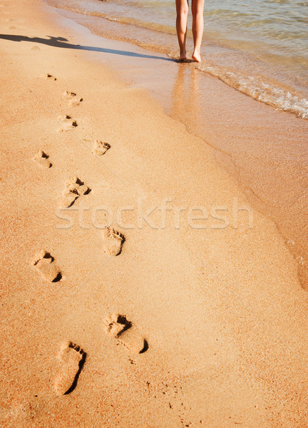 Woman walking on the beach Stock photo © Nejron