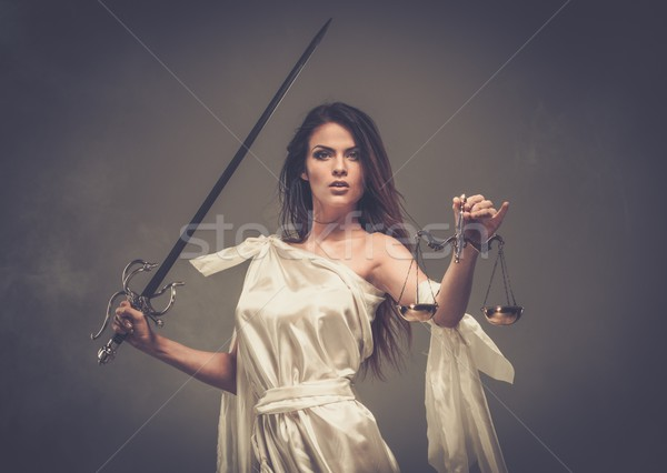 Stock photo: Femida, Goddess of Justice, with scales and sword