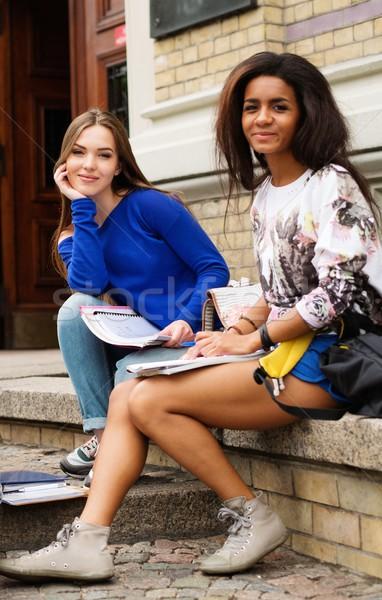 Multi ethnic girls students near university building entrance Stock photo © Nejron