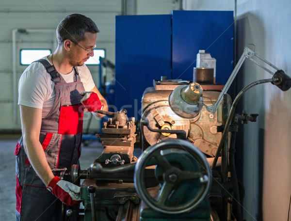 Serviceman working on lathe machine in car workshop Stock photo © Nejron