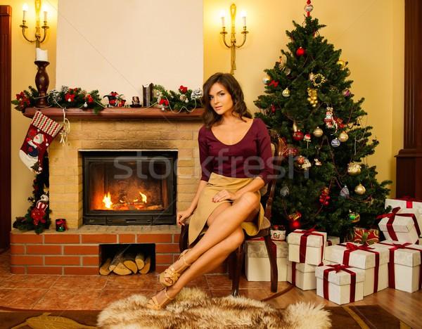 Fiatal nő kandalló karácsony díszített házbelső nő Stock fotó © Nejron