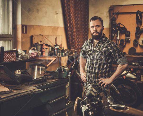 Mechanic in motorcycle custom garage Stock photo © Nejron