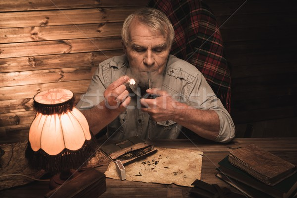 Senior man with smoking pipe in homely wooden interior  Stock photo © Nejron