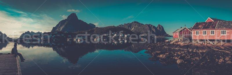 Woman sitting on a pier in Reine village, Norway  Stock photo © Nejron