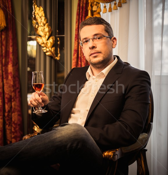 Middle-aged tasting cognac in luxury vintage style interior  Stock photo © Nejron