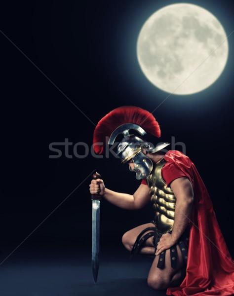 Soldado em pé joelho noite tempo luz Foto stock © Nejron