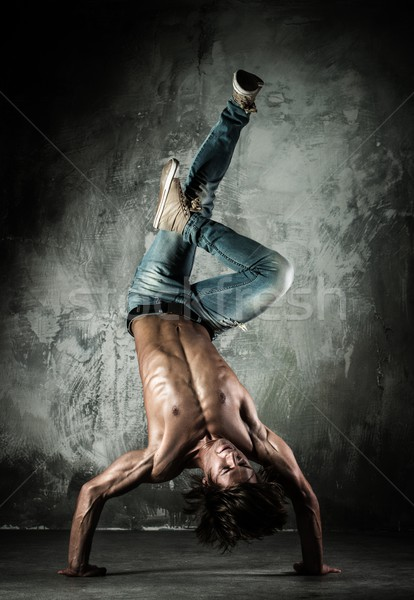 Young b-boy man with naked torso doing brake dancing movements  Stock photo © Nejron