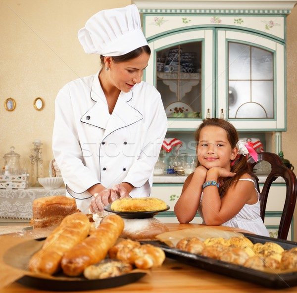 Stock photo: Mother cook with her daughter cooking homemade pastry