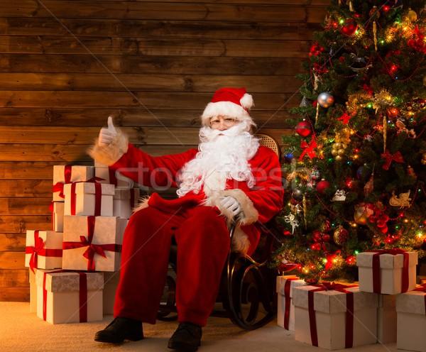 Kerstman vergadering schommelstoel duim omhoog houten Stockfoto © Nejron