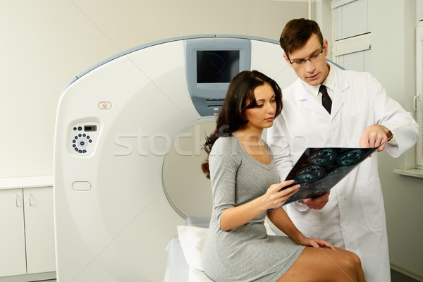 Doctor with young woman patient looking at the computed tomography results Stock photo © Nejron