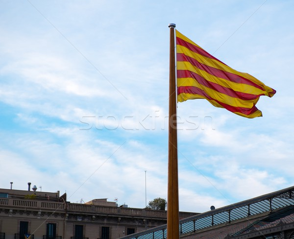 Catalan flag on a rooftop against blue sky in Barcelona, Spain Stock photo © Nejron