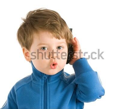 Little boy talking on the phone. Isolated on white background Stock photo © Nejron
