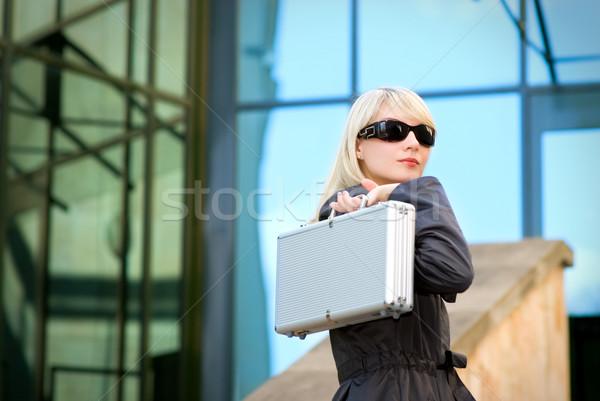 Gyönyörű fiatal nő ezüst tok modern iroda Stock fotó © Nejron