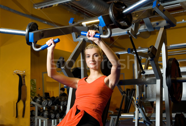 Stock photo: Beautiful woman works out in a gym