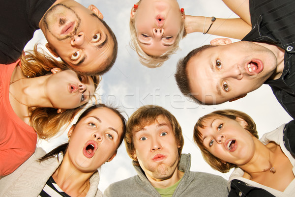 Group of happy friends making surprised faces Stock photo © Nejron