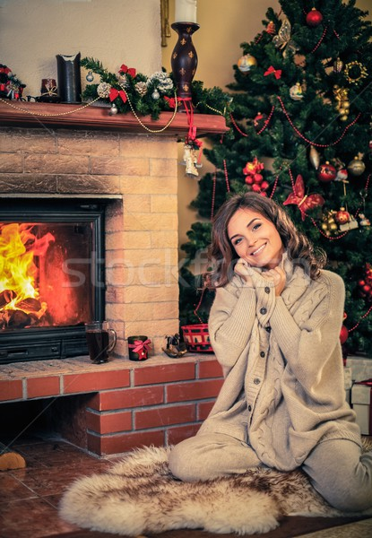 Young woman near fireplace in Christmas decorated house interior  Stock photo © Nejron