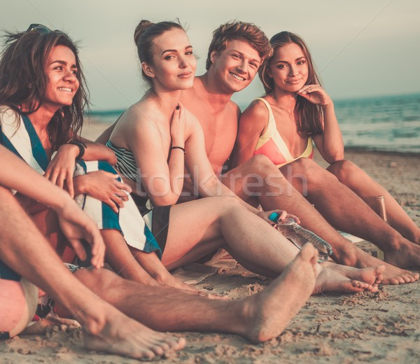 Group of multi ethnic friends  relaxing on a beach Stock photo © Nejron