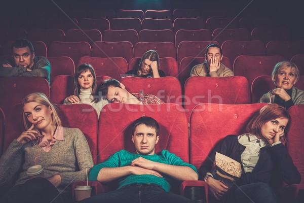 Group of people watching boring movie in cinema Stock photo © Nejron