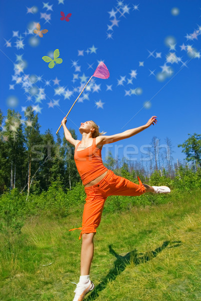 Beautiful girl with a net in her hand trying to catch magic butt Stock photo © Nejron