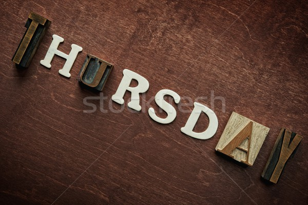 The word thursday written on wooden background Stock photo © Nejron
